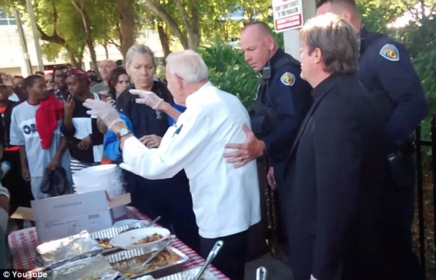 90-year-old Arnold Abbott is stopped by reluctant police for breaking Fort Lauderdale's new law against giving food to the homeless.