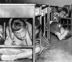 I was among that generation of schoolkids, shown here, who hid under their desks during civil defense drills of the 1950s... as a way to survive a nuclear attack. Didn't make a lot of sense even then, but grown-ups felt compelled to do SOMEthing to prepare for a hopeless situation.